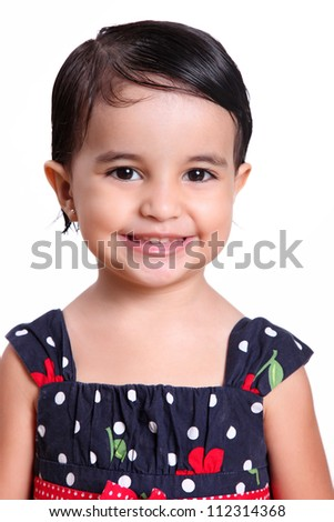 beautiful child looking to the camera with a smile - stock photo