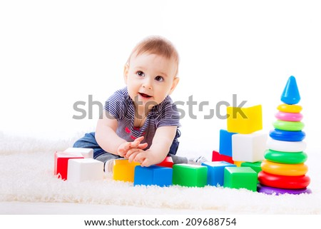 beautiful child plays cubes