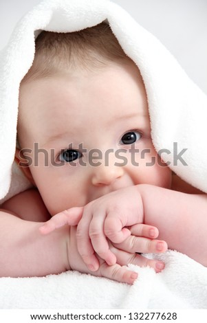 beautiful child under white blanket - stock photo
