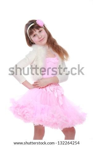 Beautiful child with beautiful hair in a pink tutu posing for the camera on white background on Beauty and Fashion