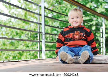 beautiful children  posing in fashionable clothing outdoor