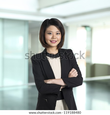 Beautiful Chinese business woman with friendly smile. - stock photo