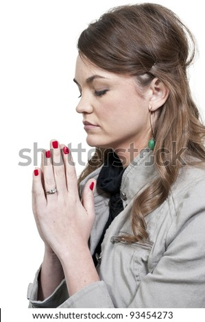 Beautiful Christian woman in a deep prayer - stock photo