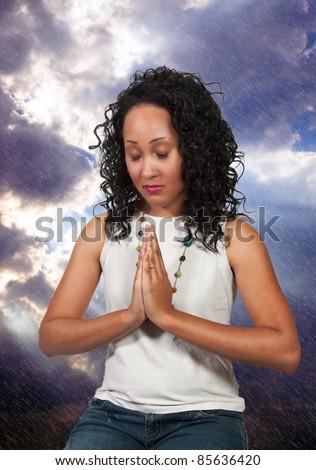 Beautiful Christian woman in deep prayer - stock photo