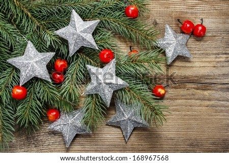 Beautiful christmas background: silver stars and apples on fir branches - stock photo