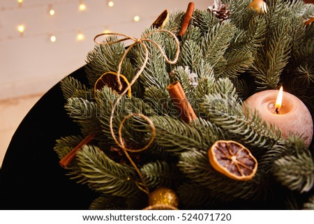 beautiful Christmas background with burning candles, Christmas wreath and decor