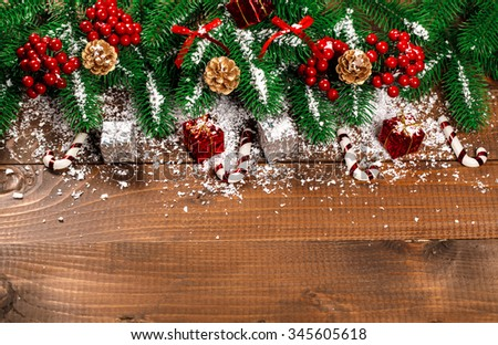 Beautiful Christmas background with the branches of the Christmas tree and snow on wooden background. View with copy space - stock photo