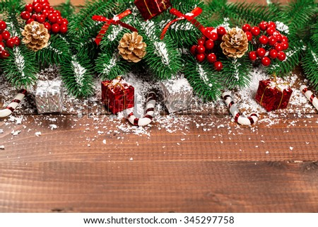 Beautiful Christmas background with the branches of the tree and snow on wooden table. View with copy space