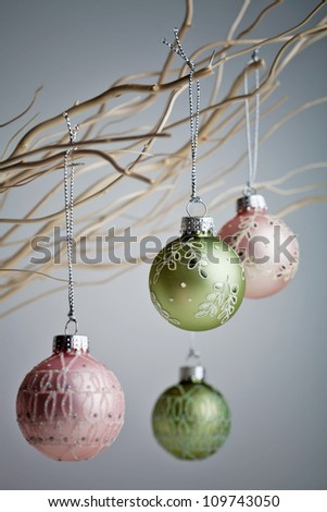 Beautiful christmas baubles hanging from white branches - stock photo