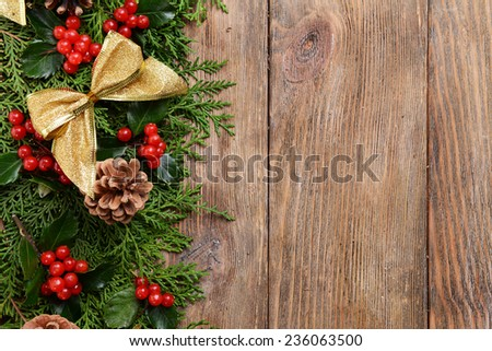 Beautiful Christmas border from fir and mistletoe on wooden background - stock photo