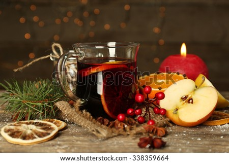 Beautiful Christmas composition of mulled wine on decorated wooden table - stock photo