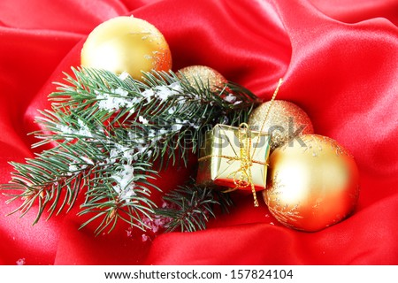 Beautiful Christmas decor on red satin cloth