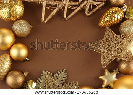 Beautiful Christmas decorations on brown background - stock photo