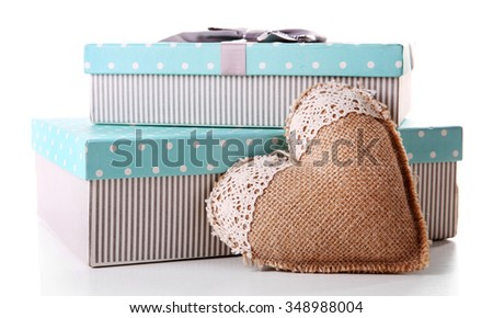 Beautiful Christmas gifts with heart  isolated on white background