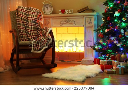 Beautiful Christmas interior with fireplace and fir tree - stock photo