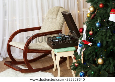 Beautiful Christmas interior with fireplace, turntable and fir tree - stock photo