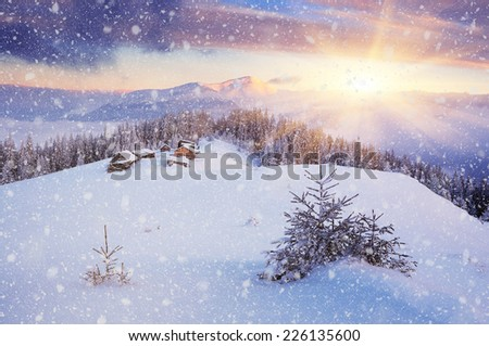 Beautiful Christmas landscape. Dawn in the mountains. The village of shepherds. Fresh snow. Carpathians, Ukraine, Europe - stock photo
