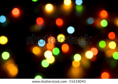 Beautiful Christmas lights  in darkness  background - stock photo