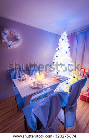 Beautiful Christmas table setting with Christmas tree