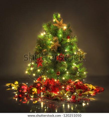 beautiful christmas tree on dark background - stock photo