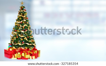 Beautiful Christmas Tree with gifts over blue banner background. - stock photo