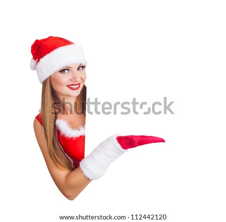 Beautiful christmas woman peeking from behind blank sign billboard - isolated on white background