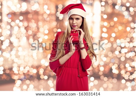 beautiful christmas woman with gifts box  - stock photo