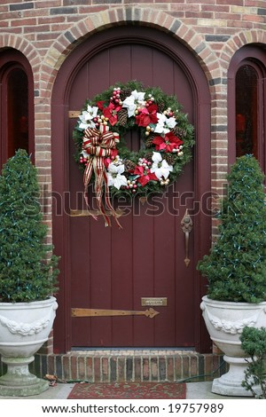 beautiful christmas wreath on brown door - stock photo