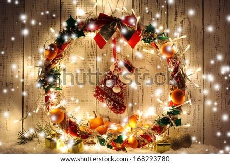 Beautiful Christmas wreath, on wooden background - stock photo