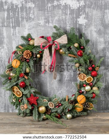 Beautiful Christmas wreath on wooden boards. Preparation for holidays concept. Flower shop is a master work of a professional florist. copy space