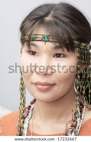Beautiful chukchi woman in folk dress - stock photo