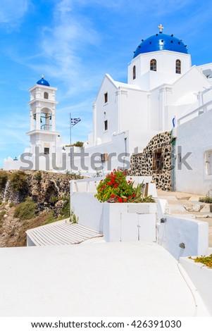 Beautiful church with blue dome in Imeroviglio village on Santorini island, Greece - stock photo