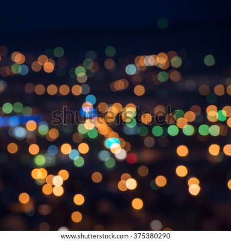 beautiful city lights background with blurring bokeh in twilight, closeup  - stock photo