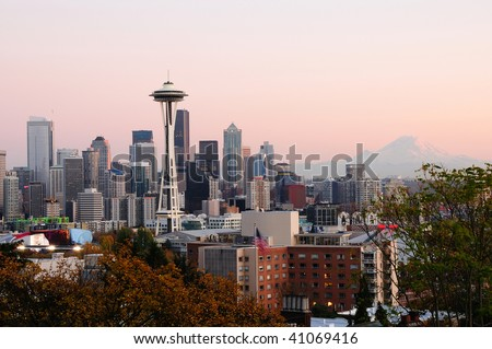 Beautiful city of Seattle glowing at dusk with Mount Rainier in the backdrop