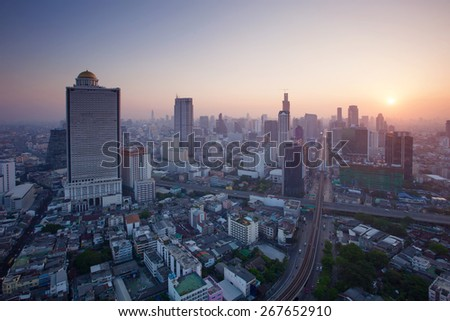 beautiful city scape urban scene  of bangkok capital of thailand in morning light glow up view from peak of sky scrapper building  - stock photo