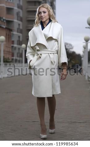 beautiful city woman  walking on a street - stock photo