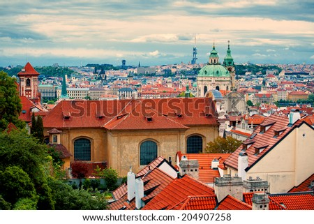 Beautiful cityscape of Prague with cathedral of St. Nicholas at sunset, Prague, Czech republic - stock photo