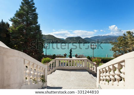 beautiful classical mansion,  grand staircase with lake view - stock photo