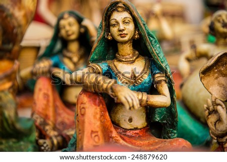 Beautiful clay dolls of miniature dancers performing in a band of classical music - stock photo