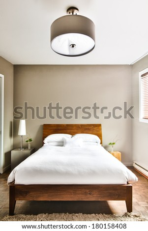 Beautiful Clean and Modern Bedroom with empty wall to add some text, logo, image, etc. - stock photo