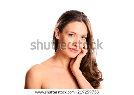 Beautiful clean faced woman on white background - stock photo