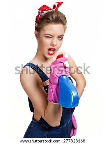 Beautiful cleaning girl wearing pink rubber protective gloves holding spray / young beautiful American pin-up girl isolated on white background. Cleaning service concept - stock photo