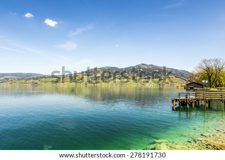 beautiful clear alpine lake Attersee with crystal water - stock photo
