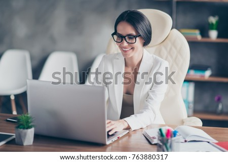 beautiful clever cute charming attractive elegant owner of big company has online meeting with international business partners, she is sitting at the table at workstation