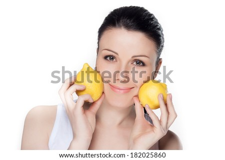 Beautiful close-up portrait of young woman with lemons. Healthy food concept. Skin care and beauty. Vitamins and minerals. - stock photo