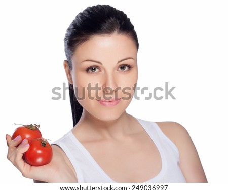 Beautiful close-up portrait of young woman with tomato. Healthy food and vegetables concept. Skin care and beauty. Vitamins and minerals.