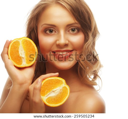 Beautiful close-up young woman with oranges. Healthy food concept.  - stock photo