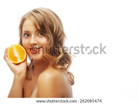 Beautiful close-up young woman with oranges. Healthy food concept.