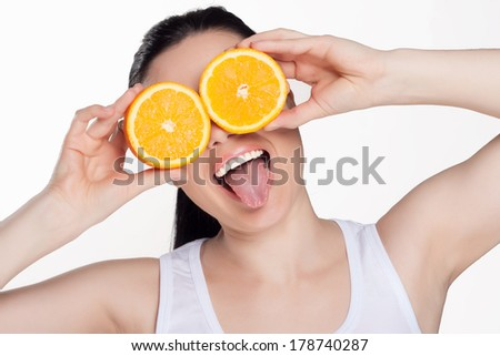 Beautiful close-up young woman with oranges. Healthy food concept. Skin care and beauty. Vitamins and minerals.