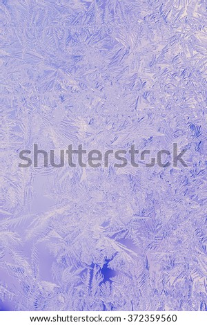 Beautiful Closeup Winter Colorful Background With Icy Frost Patterns - stock photo